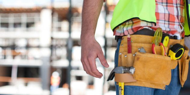 Close up of construction worker's tool belt on construction