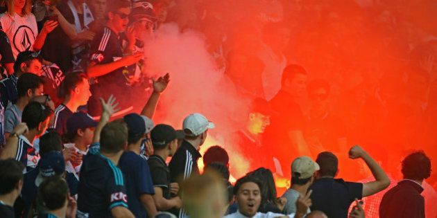 MELBOURNE, AUSTRALIA - FEBRUARY 13: A flare is ignited in the Melbourne Victory supporters area of the...