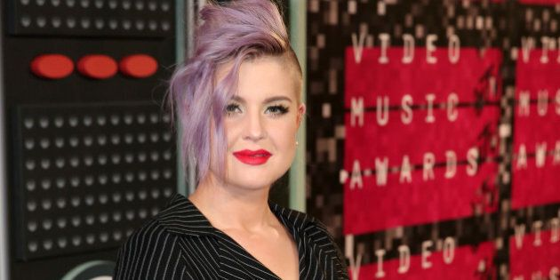 Kelly Osbourne arrives at the MTV Video Music Awards at the Microsoft Theater on Sunday, Aug. 30, 2015,...