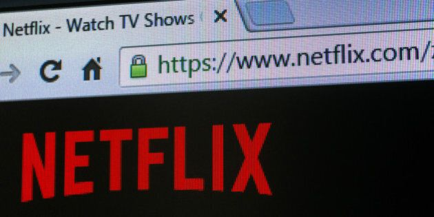 The website for the Netflix Inc. video streaming service sits on a mobile device screen in Johannesburg,...
