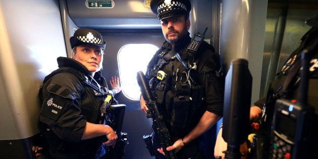 Armed police patrol trains in Britain for the first time after the terror threat was elevated to