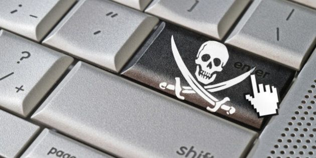 Business concept mouse cursor pressing pirate enter key on metallic