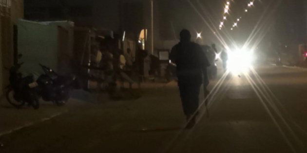 In this grab taken from video by Associate Press Television, an armed policeman patrols the area after...