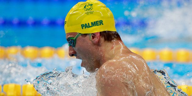 Joshua Palmer competes in the Men's 100m Breaststroke heat 3 on Day 1 of the Rio 2016 Olympic Games at...