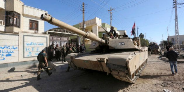 Iraqi security forces clear the Soufiya neighborhood of Islamic State fighters in central Ramadi, 70...
