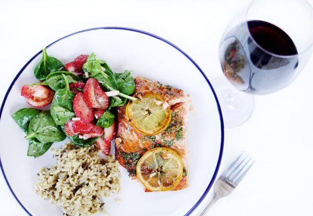 Fresh salmon, rice and salad with Shiraz.