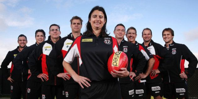 MELBOURNE, AUSTRALIA - JUNE 02:  New Saints Development coach Peta Searle, the AFL's first female assistant coach, poses with the coaching team during a St Kilda Saints AFL press conference at Linen House Oval on June 2, 2014 in Melbourne, Australia.  (L-R): Lindsay Gilbee, Adam Kingsley, Simon McPhee, Danny Sexton, Peta Searle, Alan Richardson, Paul Hudson, Aaron Hamill and David Teague. (Photo by Michael Dodge/Getty Images)
