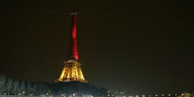 A picture taken on March 24, 2016 shows the Eiffel Tower in Paris illuminated in colours of the Belgian flag in tribute to the victims of terrorist attacks in Brussels, two days after a triple bomb attack, claimed by the Islamic State group, hit Brussels' airport and the Maelbeek - Maalbeek metro station, killing 31 people and wounding 300 others. / AFP / LUDOVIC MARIN        (Photo credit should read LUDOVIC MARIN/AFP/Getty Images)