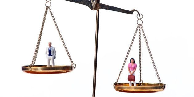 Men and women on equal scale.Symbol