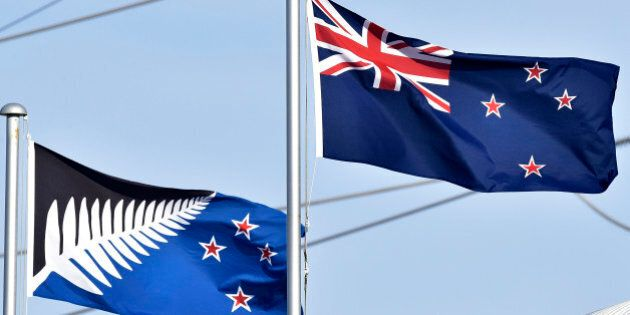 The current New Zealand flag (R) flutters next to the alternative flag (L) in Wellington on March 4,...