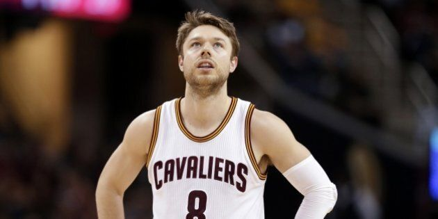 Cleveland Cavaliers' Matthew Dellavedova, from Australia, waits for action to resume in the second half...