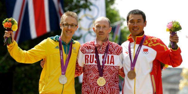 Gold-medallist Sergey Kirdyapkin of Russia, center, stands with silver-medallist Jared Tallent of Australia,...