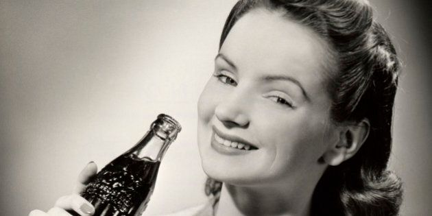 UNITED STATES - CIRCA 1950s: Teenage girl with bottle of