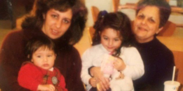 My mother and grandma with me and my sister. My cardigan game was better back then.