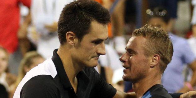 NEW YORK, NY - SEPTEMBER 03: Bernard Tomic of Australia shakes hands with Lleyton Hewitt of Australia...