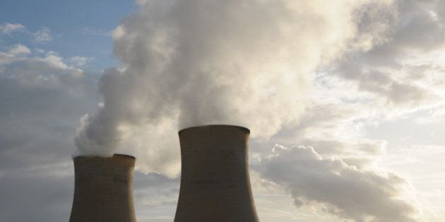 Steam billows from the cooling towers of Great Energy Alliance Corp.'s Loy Yang coal-fired power station...