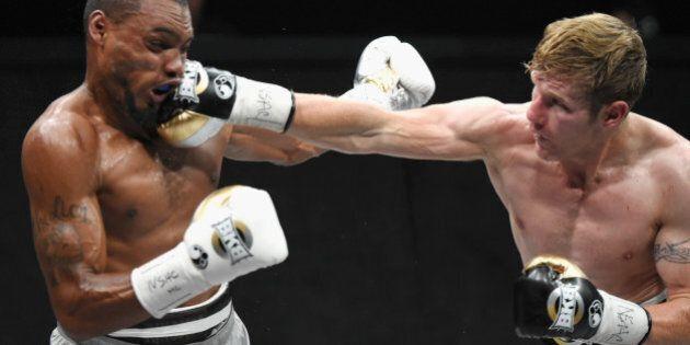 LAS VEGAS, NV - JUNE 27: Boxer Ed Paredes (silver trunks) fights Janks Trotter (black trunks) during...