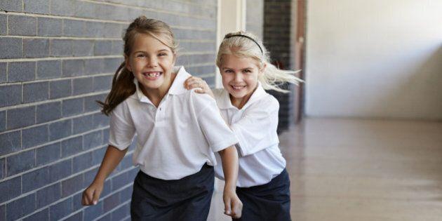 Schoolgirls running & having fun in a
