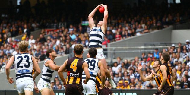 MELBOURNE, VICTORIA - MARCH 28:  Patrick Dangerfield of the Cats takes a spectacular mark during the round one AFL match between the Geelong Cats and the Hawthorn Hawks at the Melbourne Cricket Ground on March 28, 2016 in Melbourne, Australia.  (Photo by Scott Barbour/AFL Media/Getty Images)