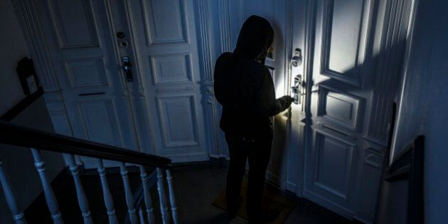 BERLIN, GERMANY - JUNE 27:  Posed scene of a man breaking into an apartment on June 27, 2014, in Berlin, Germany. The photo symbolizes the increasing risk of burglary in Germany. (Photo by Thomas Trutschel/Photothek via Getty Images)