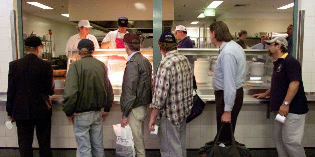 Homeless men line-up for food at the St Vincent de Paul Society soup kitchen called the Mathew Talbot...