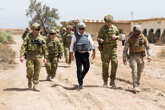 (Centre) Shadow Minister for Defence, The Honourable Richard Marles, MP, talks with Commander Task Group...