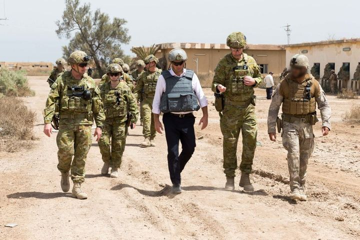(Centre) Shadow Minister for Defence, The Honourable Richard Marles, MP, talks with Commander Task Group Taji 4, Australian Army officer Colonel Richard Vagg, about training Iraqi Security Forces at Taji Military Complex, Iraq.
