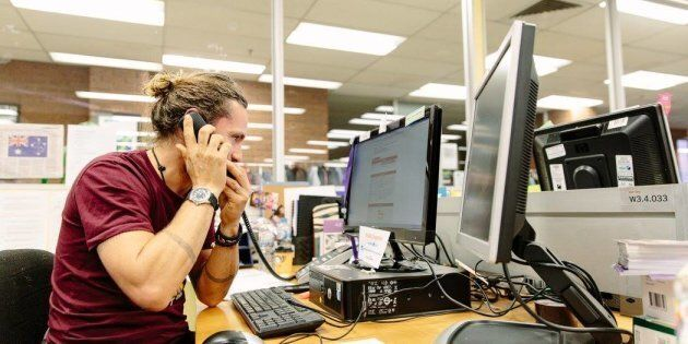 Musician John Butler answers phones during the ASRC's 2016