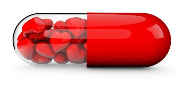 3D render of a pill tablet filled with red love