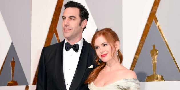 Sacha Baron Cohen, left, and Isla Fisher arrive at the Oscars on Sunday, Feb. 28, 2016, at the Dolby...