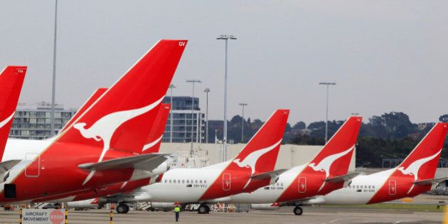 The tails of Qantas planes are lined up at Sydney Airport in Sydney, Sunday, Oct. 30, 2011. Qantas Airways...