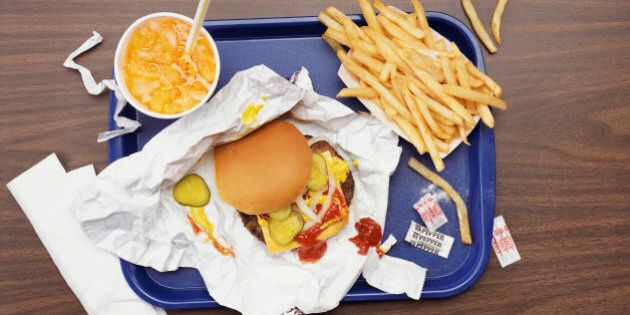 Elevated View of a Tray With Fries, a Hamburger and