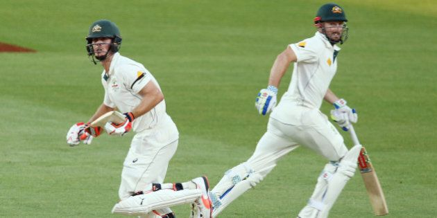ADELAIDE, AUSTRALIA - NOVEMBER 29: Brothers, Mitch Marsh and Shaun Marsh run between the wickets during...