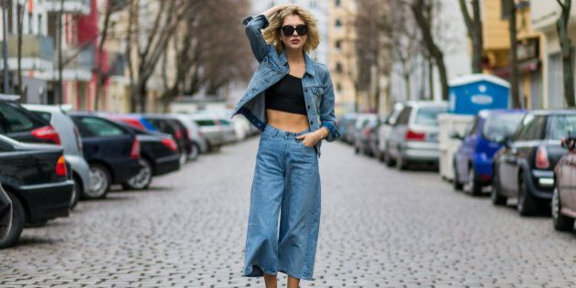BERLIN, GERMANY - MARCH 24: Fashion blogger Ebba Zingmark wearing a blue denim jacket 7 8 wide jeans, black sunglasses, a black cropped top and black Nike sneaker on March 24, 2016 in Berlin, Germany (Photo by Christian Vierig/Getty Images )