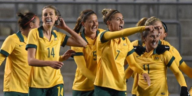 OSAKA, JAPAN - FEBRUARY 29: Australia celebrate their 3rd goal of Katrina Gorry of Australia during the AFC Women's Olympic Final Qualification Round match between Australia and Japan at Kincho Stadium on February 29, 2016 in Osaka, Japan. (Photo by Kaz Photography/Getty Images)