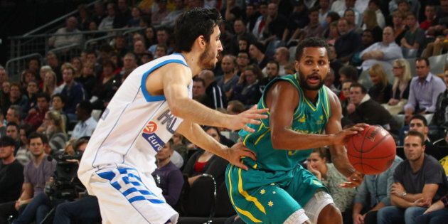MELBOURNE, AUSTRALIA - JUNE 24: Patty Mills of Australia is pressured by his opponent during the first...