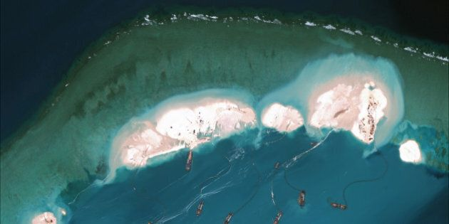 MISCHIEF REEF, CHINA - MARCH 16, 2015:  DigitalGlobe imagery from 16 March 2015 shows significant construction and dredging underway at Mischief Reef.  New structures, fortified seawalls, and construction equipment are present at multiple sites.  (Photo DigitalGlobe via Getty Images)