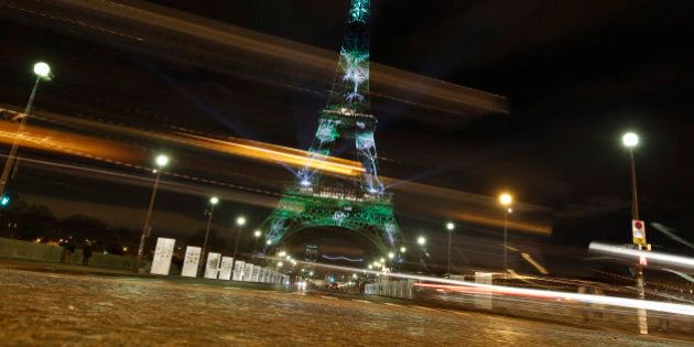 An artwork entitled 'One Heart One Tree' by artist Naziha Mestaoui is displayed on the Eiffel tower as...