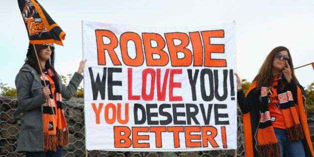 SYDNEY, AUSTRALIA - AUGUST 30: Robbie Farah supporters in the crowd hold up a sign during the round 25...