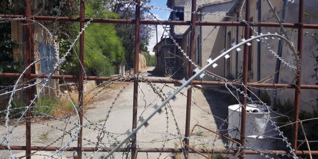 DERYNEIA, CYPRUS - 2016/05/06: Razor wire and metal fencing blocks off a road in the old city area of Nicosia. The divided city is the capital of both the Republic of Cyprus and the Turkish Republic of Northern Cyprus. (Photo by Dominic Dudley/Pacific Press/LightRocket via Getty Images)