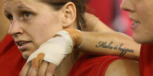 MELBOURNE, AUSTRALIA - AUGUST 16: A Tattoo on an arm is seen on a Demon player during a Women's AFL exhibition...