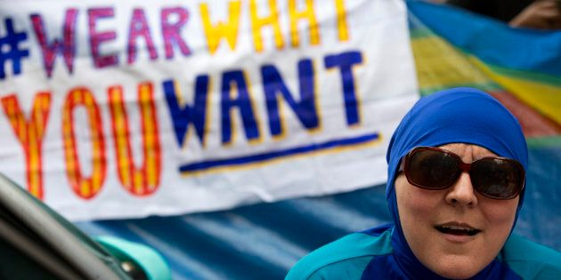 A woman wearing a 'Burkini' joins a protest outside the French Embassy in London on August 25, 2016,...