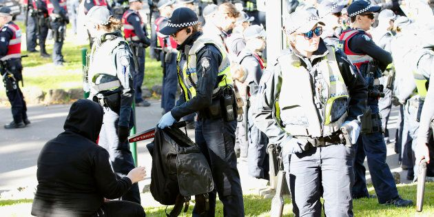 Police conducted searches at the opposing rallies.