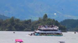 'Horrific' Scenes As Packed Tourist Ferry Sinks In Colombian