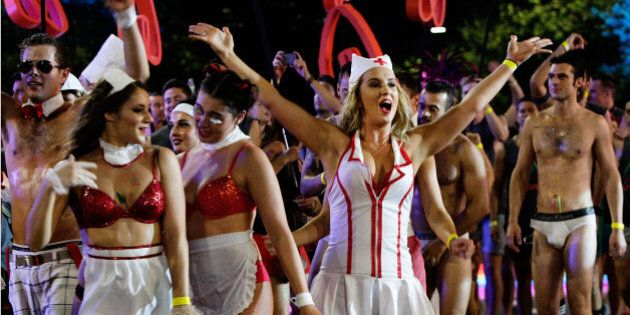 SYDNEY, AUSTRALIA - MARCH 07: Parade goers make their way along Oxford Street during the 2015 Sydney...