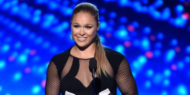 UFC fighter Ronda Rousey accepts the best female athlete award at the ESPY Awards at the Microsoft Theater...