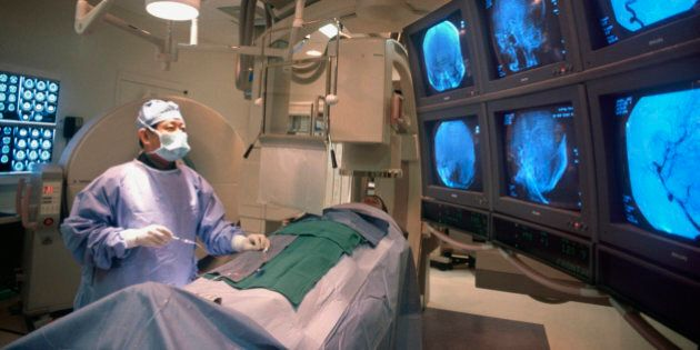 Doctor performing brain surgery on patient