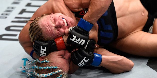 OKLAHOMA CITY, OK - JUNE 25:   (L-R) Felice Herrig attempts to secure a rear choke submission against Justine Kish in their women's strawweight bout during the UFC Fight Night event at the Chesapeake Energy Arena on June 25, 2017 in Oklahoma City, Oklahoma. (Photo by Brandon Magnus/Zuffa LLC/Zuffa LLC via Getty Images)