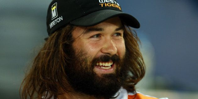 SYDNEY, AUSTRALIA - MARCH 27: Injured Tigers player Aaron Woods watches from the sideline during the...