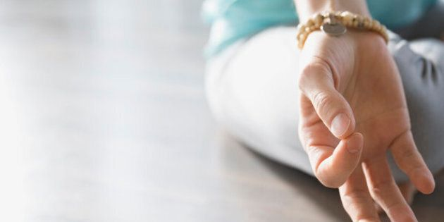 Close up of woman practicing mudra meditation